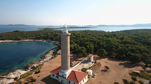 Aerial - Flying away from the tower top of Punta Bjanca lighthouse in the Adriat Footage