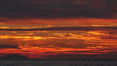 Time lapse - Red sunset over the ocean sea Footage