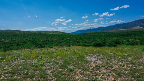 Time lapse - Hilly landscape of Dinaric Alps on a sunny day with blue sky Live Action