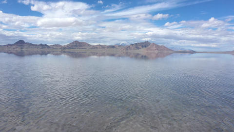 Aerial view flying over the Bonneville Salt Flats covered in water Live Action