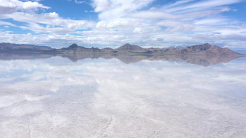 Panning aerial view of the Bonneville Salt Flats under water Live Action