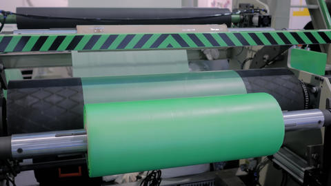 Automatic plastic bag making machine - roller with green polyethylene film Live Action