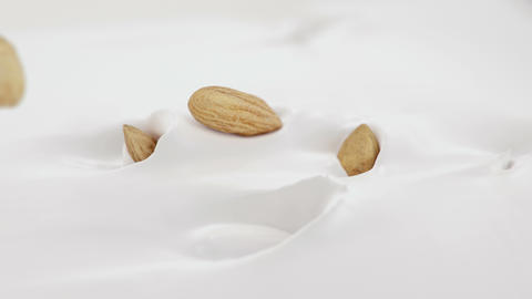 Almonds Nuts Splash Into Liquid Cream in 4K Super slow motion Live Action