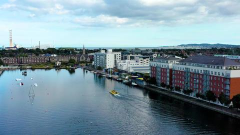 Amphibious vehicle sailing on city canal Live Action