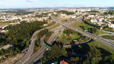 Car Driving on Highway Intersection in City Aerial View Car Traffic on Freeway Live Action