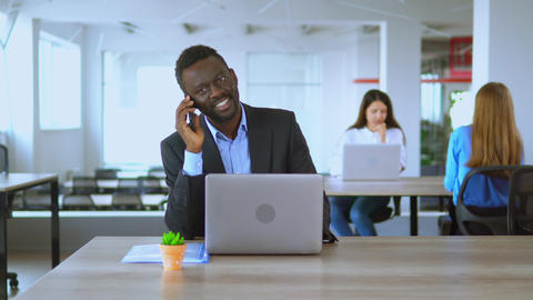 handsome man office employee communication by phone at workplace Live Action