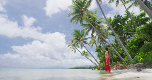 Vacation travel woman relaxing on paradise beach with palm trees on holidays Live Action