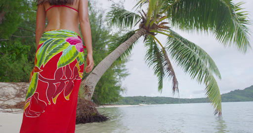 Travel woman walking on paradise beach on holidays vacation on Bora Bora Live Action