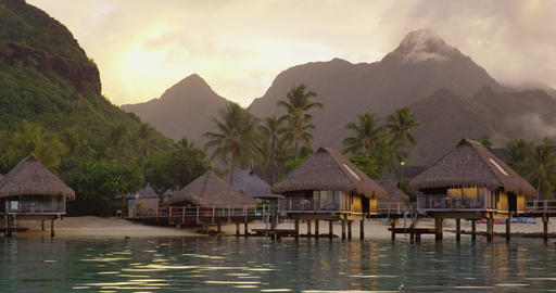 Travel vacation luxury resort hotel overwater bungalows on paradise beach Live Action