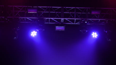 Colorful bright blue and purple concert lighting equipment for stage at club Live Action