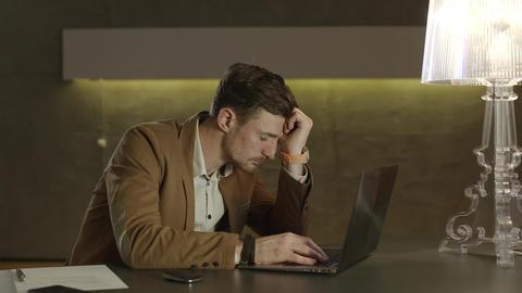 Businessman tired after work with his laptop computer Footage