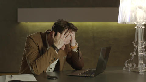 Businessman in a hotel dropping his head with tiredness Footage