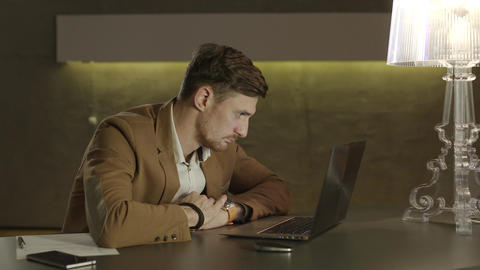Young businessman inert when sitting in front of his laptop computer Footage