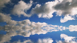 Time lapse clouds and water drops on reflective surface Footage
