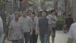 Street in Beijing. A crowd of people on the streets of Beijing. China Footage