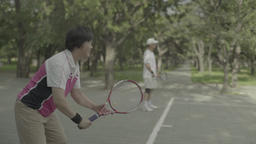 Beijing. China. People play tennis in the Park Live Action