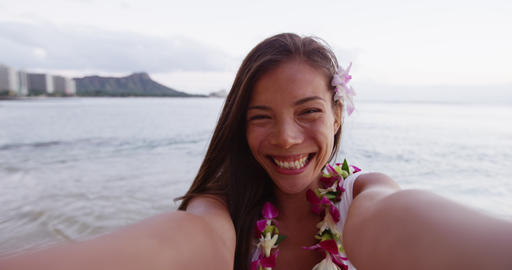 Cheerful Young Woman Puckering Lips While Taking Selfie At Waikiki Beach Live Action