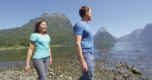 People hiking in New Zealand in Milford Sound by Mitre Peak in Fiordland Live Action