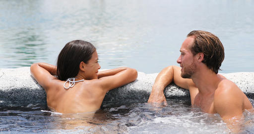Spa couple happy in wellness hot tub jacuzzi Live Action