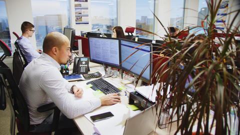 professional team works on computers sitting at workplaces GIF