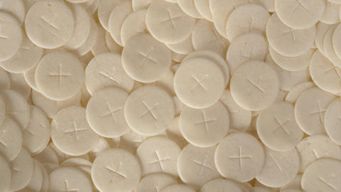 communion hosts sacramental breads turning round rotating flat lay top view ライブ動画