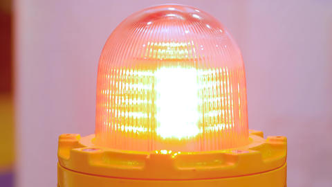 Close up of alarm lamp signal warning flashing light for industrial machinery Live Action
