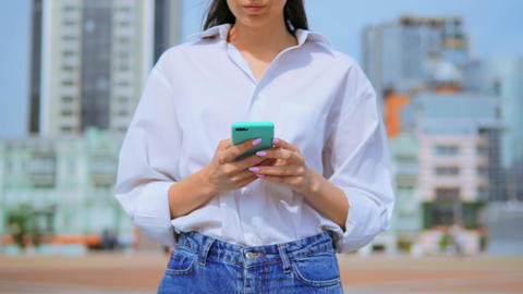 details woman holding smartphone walks urban city background Live Action