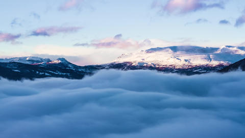 Timelapse Scenery of Clouds Floating Over Snowy Mountain at High Altitude Live Action