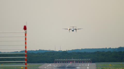 Turboprop airplane on final approach for landing Live Action