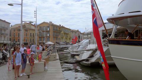 Port of Saint Tropez is a popular place for tourists- ST TROPEZ, FRANCE - JULY Live Action