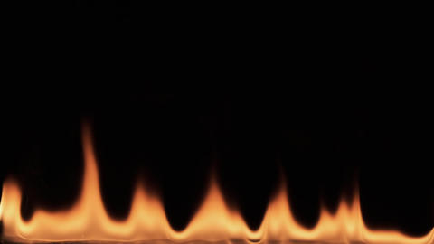 Slow motion, burning fire on black background. Texture of fire on a black Live Action