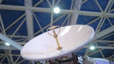 White rotating satellite dish antenna using to receive or transmit information Live Action