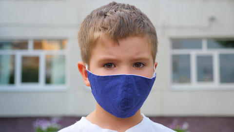 Face mask for protection coronavirus outbreak. Child wearing a medicine mask Live Action