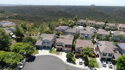 Aerial view of Torrey Santa Fe, middle class subdivision neighborhood with Acción en vivo