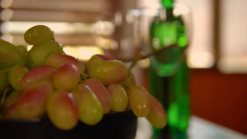 bottle of wine and fruits with bokeh effect Live-Action