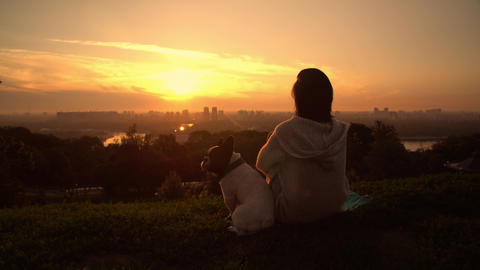 women with french bulldog at sunset Live Action