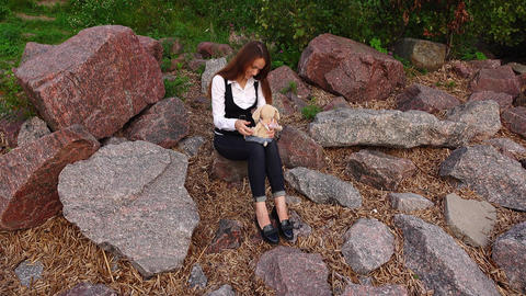Trendy white collar woman escape from office, sit and play with soft toy Live Action