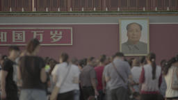 The people on Tiananmen square, near the portrait of Mao Zedong. Beijing Footage