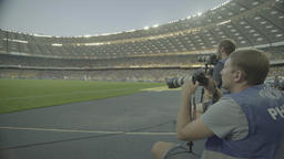 Photo.Photographer working in the stadium during the match. Media. Press Footage