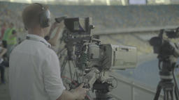 Media.The cameraman behind the camera during the live broadcast at the stadium Footage