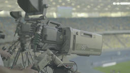 Professional TV camera with a big lens during the broadcast Footage