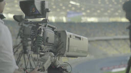 Press. Cameraman with a camera at the stadium during the live broadcast Live Action