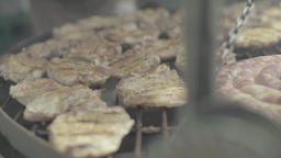 Pieces of meat are fried on the grill Footage