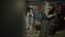 Man and woman dancing in a cafe in the evening Footage