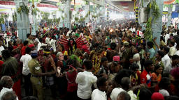 Devotees dancing in crowd at Hindu festival in Sri Mutharamman Temple at Thoothu Footage