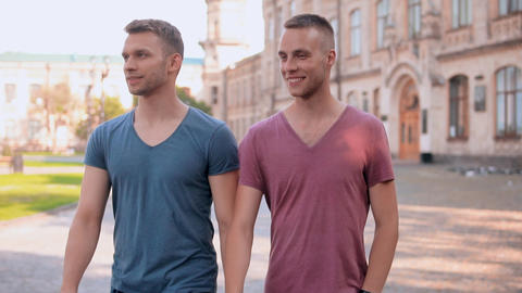 handsome friends speaking stroll on the street Live Action