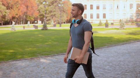 caucasian student s walks in city park Live Action