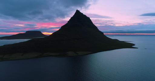 Drone aerial 4K video of Iceland nature Kirkjufell mountain landscape at sunset Live Action