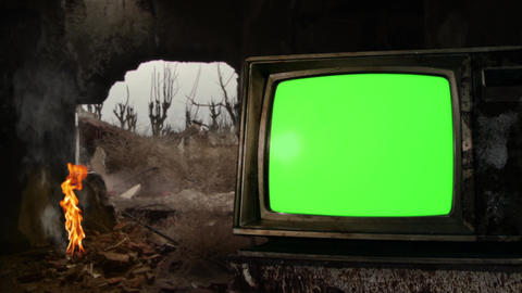 Old TV Green Screen by a Bonfire on a Demolished Building in a War Zone GIF