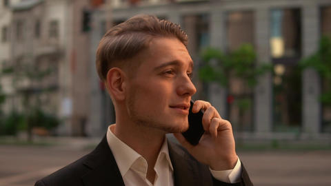 attractive guy using smartphone in city Live Action